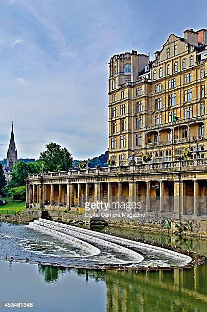 Old Georgianera buildings alongside the River Avon in Bath with the Pulteney Bridge just out of shot taken on March 31 2013