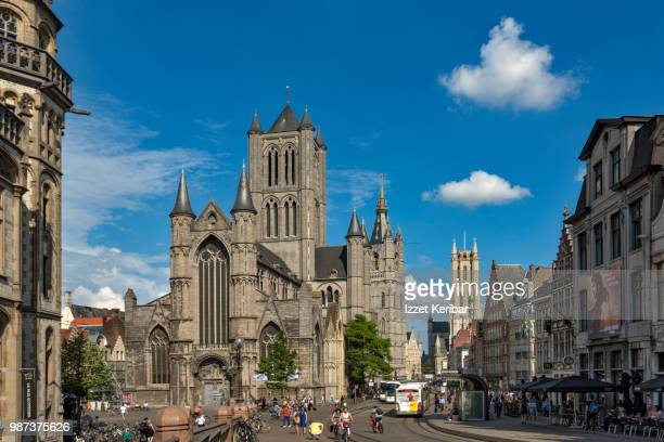 old ghent, st nicholas church ,belfort bell tower and st bavo's cathedral  in the background. , belgium. - st. nicholas cathedral stock pictures, royalty-free photos & images