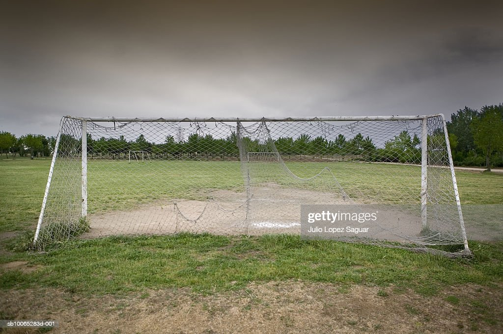 Old goalpost on football field : Foto stock