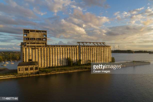 old grain elevators, wind turbines, lake erie, buffalo, new york - buffalo new york state stock pictures, royalty-free photos & images