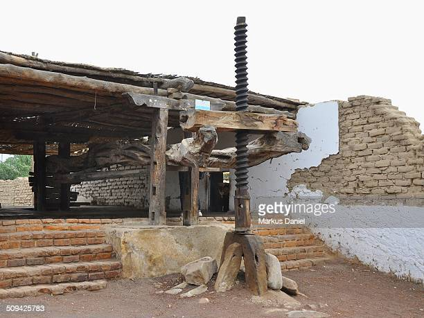"old grape press for pisco production - ""markus daniel"" stockfoto's en -beelden"