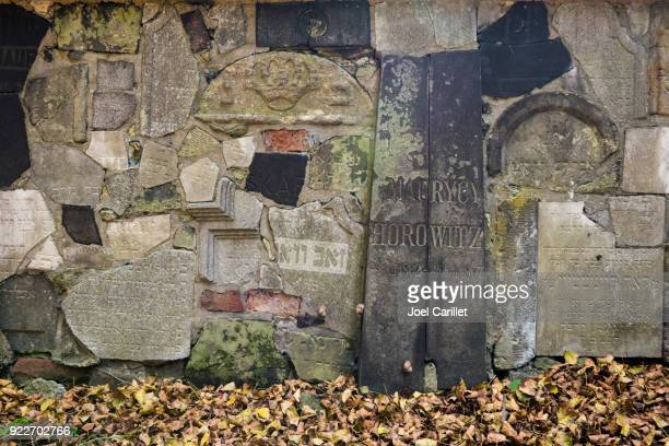 old gravestones on wall at new jewish cemetery in karkow, poland - judaism stock pictures, royalty-free photos & images