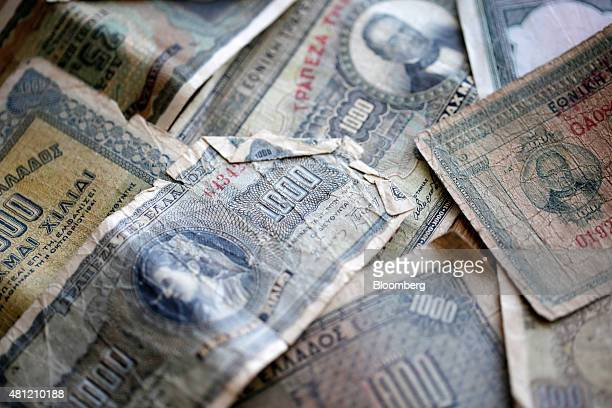 Old Greek drachma banknotes are arranged for a photograph in Athens Greece on Saturday July 18 2015 Greek banks will reopen on Monday as Prime...