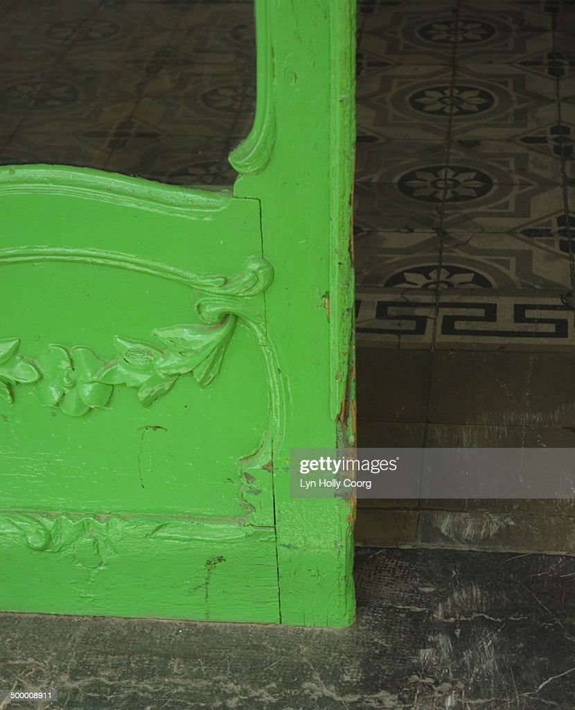 Old green door leading to tiled hallway : Stock Photo