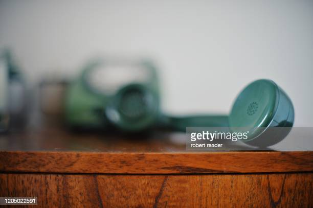 old green telephone handset receiver - telephone stock pictures, royalty-free photos & images