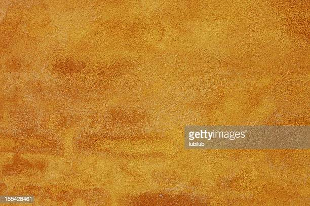 Old grunge yellow wall texture