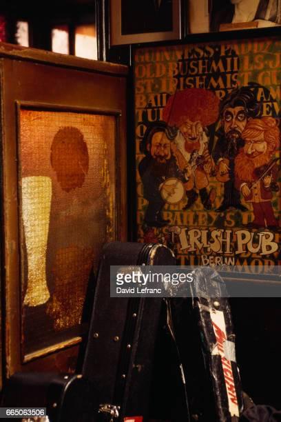 Old guitar cases lean against an old Irish Mist liquor mirror in O'Donoghue's pub Merrion Row Dublin It was in this bar that renowned Irish folk...