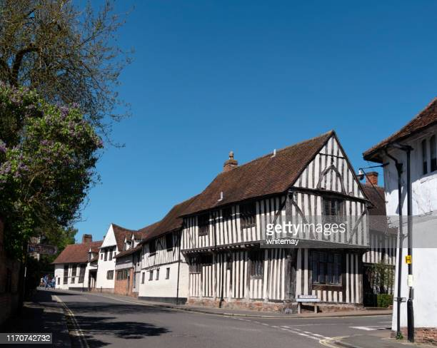 old half-timbered buildings in water street, lavenham, suffolk - lavenham stock photos and pictures