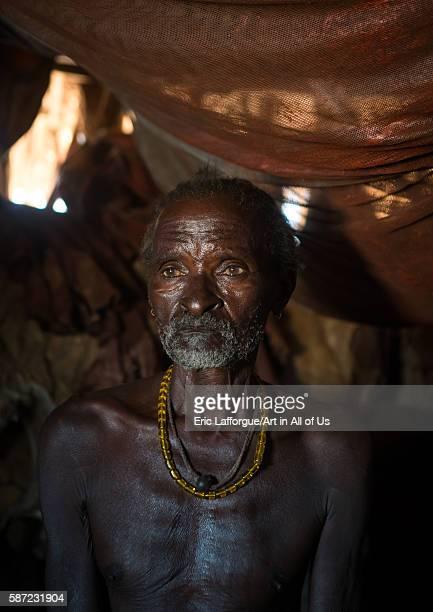 Old hamer tribe man in his hut omo valley turmi Ethiopia on March 13 2016 in Turmi Ethiopia