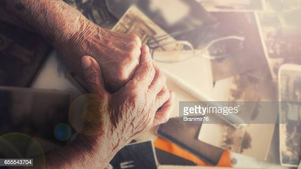 Old hand of grandmother with her memories