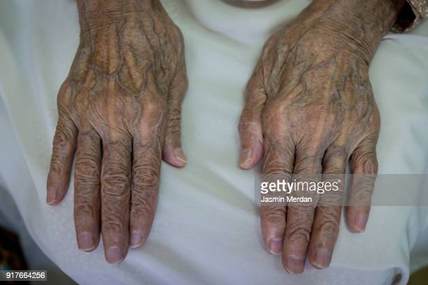 old hands closeup - gerontology stock pictures, royalty-free photos & images