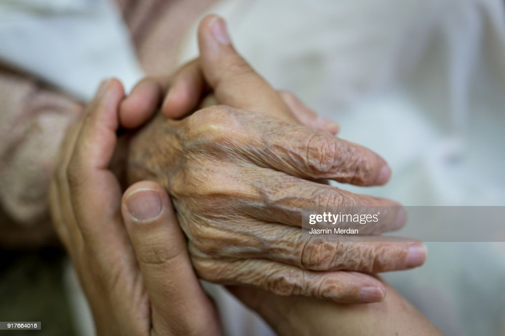 Old hands help and love : Stock Photo