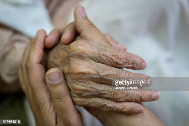 old hands help and love - forgiveness stock pictures, royalty-free photos & images