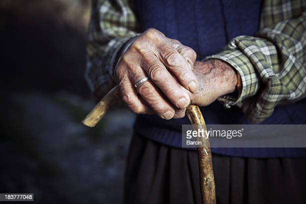 Old hands with walking stick