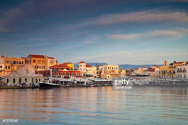 old harbor of chania and reflections in calm water - creta fotografías e imágenes de stock