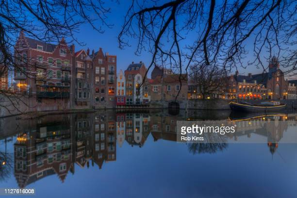 Old harbour of Rotterdam ( Delfshaven ) with Zakkendragershuisje and Pelgrimskerk at Night