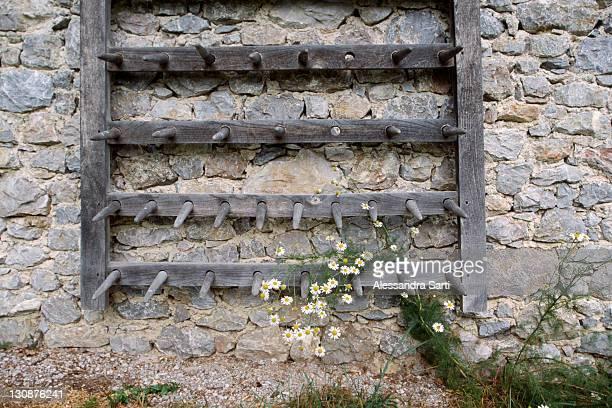Old harrow on a stone wall, North Tyrol, Austria, Europe