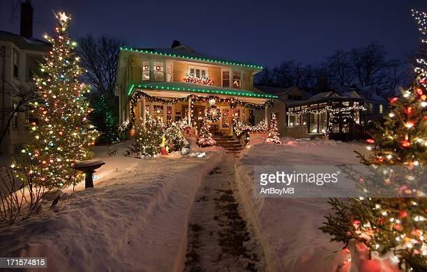 old historic home with christmas lights - illuminated stock pictures, royalty-free photos & images