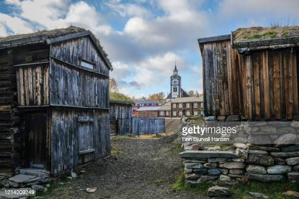 old historical buildings at røros norway, røros church in the background - finn bjurvoll stock pictures, royalty-free photos & images