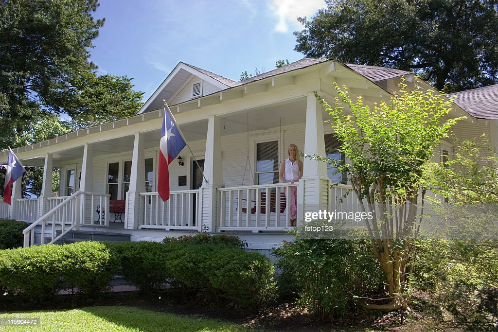 Old historical home in southern USA. Front porch. Woman. Texas. : Stock Photo