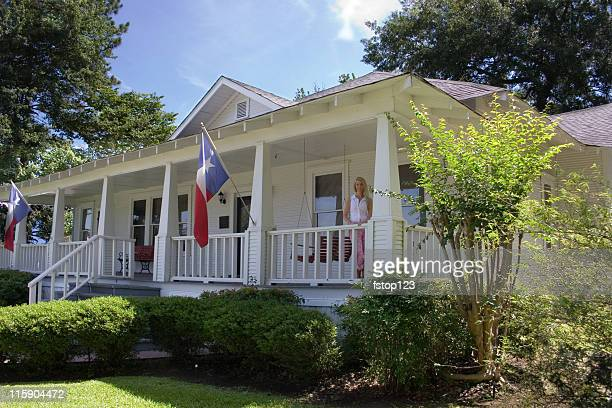old historical home in southern usa. front porch. woman. texas. - texas stock pictures, royalty-free photos & images