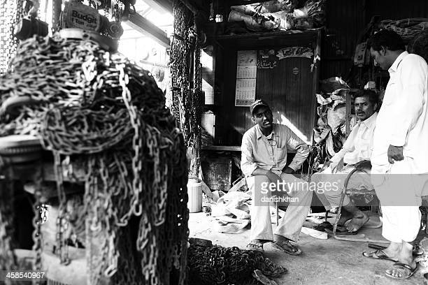 old hoists and cranes at shop in karachi scrap market - run down stock pictures, royalty-free photos & images