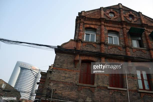 old house facade in shanghai, china - bad condition stock photos and pictures