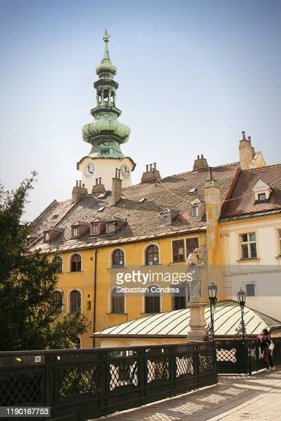 old house roof tile and michal tower ( michalska brana ) in bratislava, slovakia. - bratislava stock pictures, royalty-free photos & images