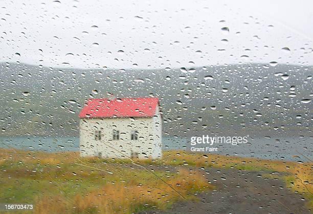 Old house through a rainy window