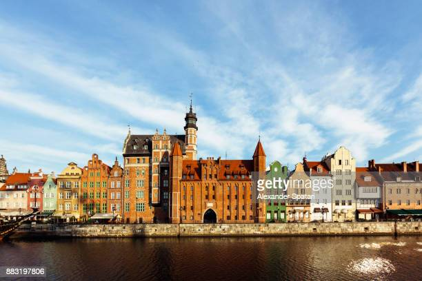 old houses at the motlawa river waterfront, gdansk, poland - poland stock pictures, royalty-free photos & images