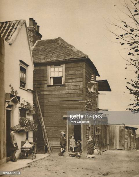 Old Houses in Highgate From Whose Doorways Villagers Watched the Coaches Pass' circa 1935 Clapboard houses in Townsend Yard north London on the old...