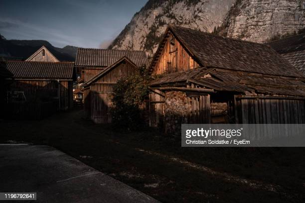 old houses in village in city - christian soldatke stock pictures, royalty-free photos & images