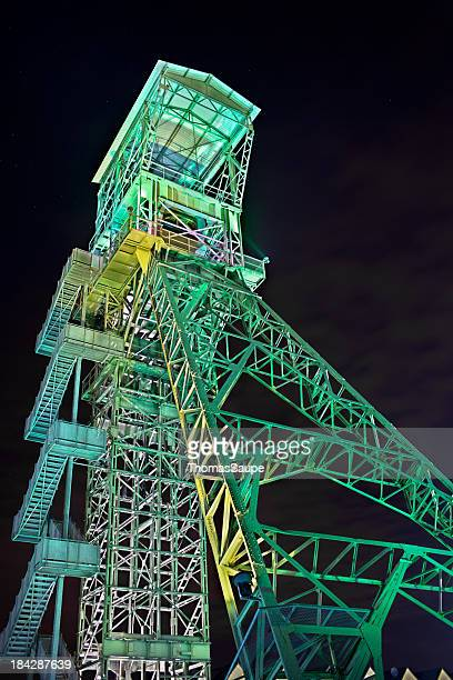 old illuminated mine head frame - mine elevator stock pictures, royalty-free photos & images