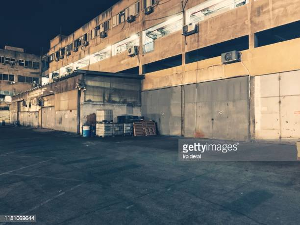 old industrial building at night - industrial district stock pictures, royalty-free photos & images
