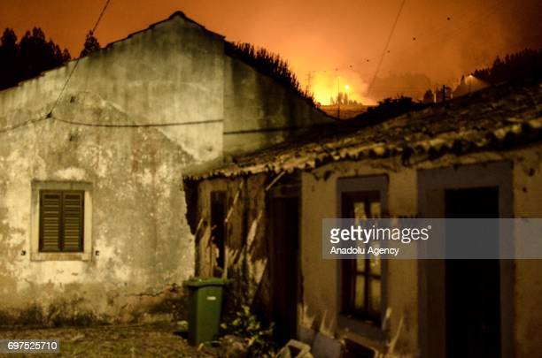 Old inhabited houses near fire in Rua de Santo Amaro, Rascoia, Portugal on June 18, 2017. A forest fire has claimed 61 lives in Portugal, the...