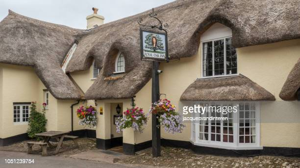 old inn in the small village of winsford in exeter (england, united kingdom) - inn stock pictures, royalty-free photos & images