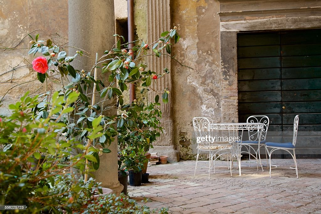 Old inner courtyard with roses in Orvieto, Italy : Stock Photo