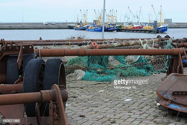 old iron parts and nets in the harbour of lauwersoog - sail boom stock pictures, royalty-free photos & images