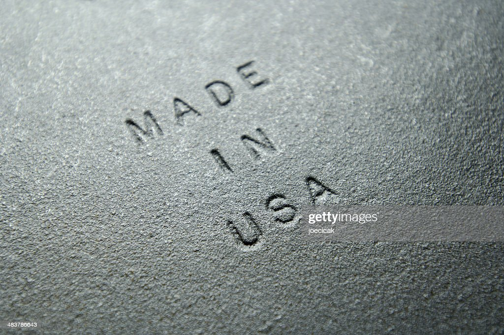 Old Iron Plate Embossed with MADE IN USA : Stock Photo