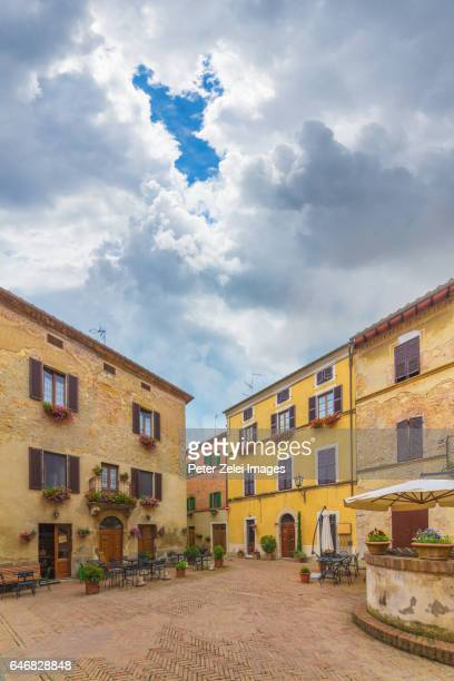 old italian town (pienza in tuscany, italy) - courtyard stock photos and pictures