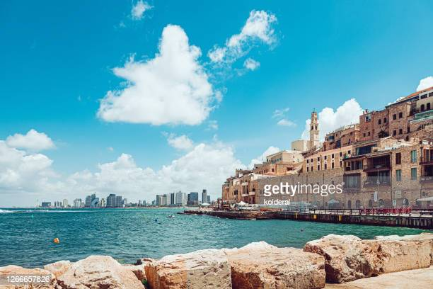 old jaffa and distant view of modern tel aviv buildings - tel aviv stock pictures, royalty-free photos & images