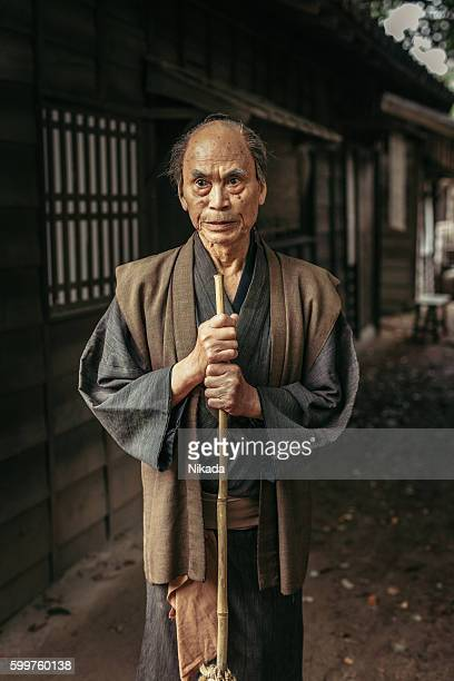 old Japanese Man with straw broom