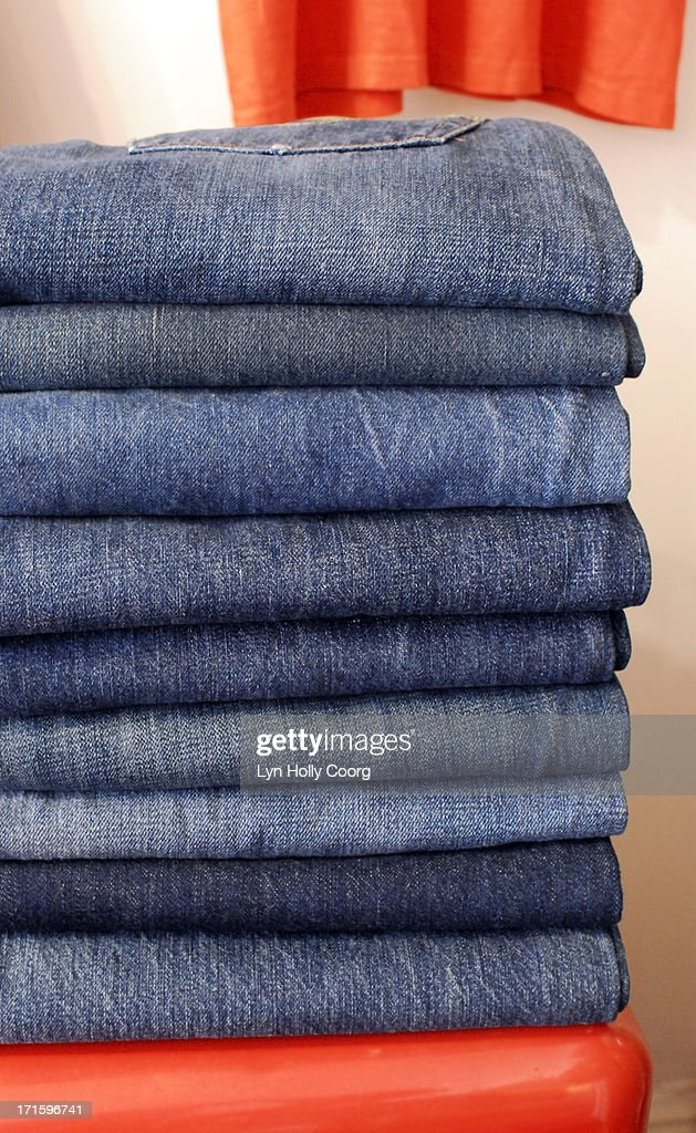Old jeans for sale in market place : Stock Photo