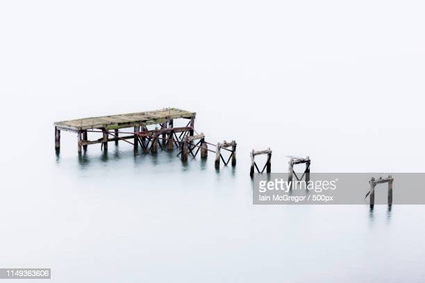 old jetty at aberdour, scotland - mcgregor stock pictures, royalty-free photos & images