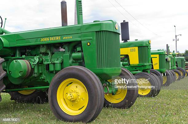old john deere tractors - john deere stock pictures, royalty-free photos & images