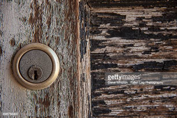 Old key lock on an abandoned house
