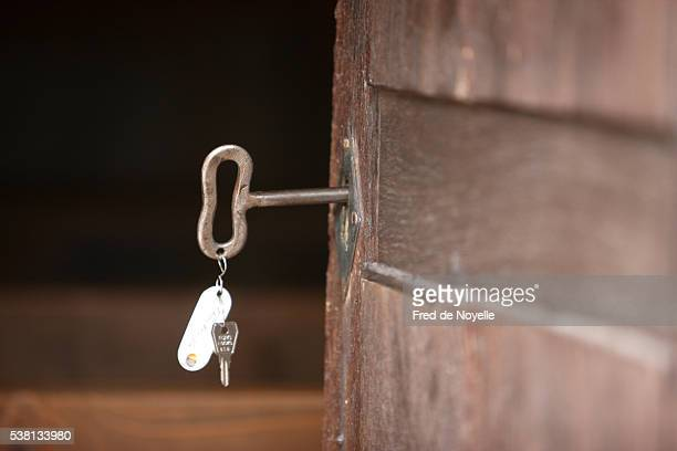 old key on the door of a church. - sallanches stock pictures, royalty-free photos & images