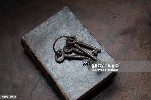 Old keys on top of an old book