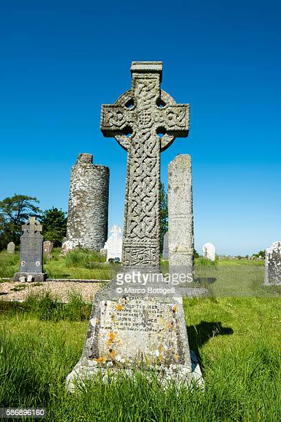 Old Kilcullen (Cill Chuilinn), County Kildare, Leinster province, Ireland, Europe. Decorated High Cross and Round Tower in the old historic graveyard.