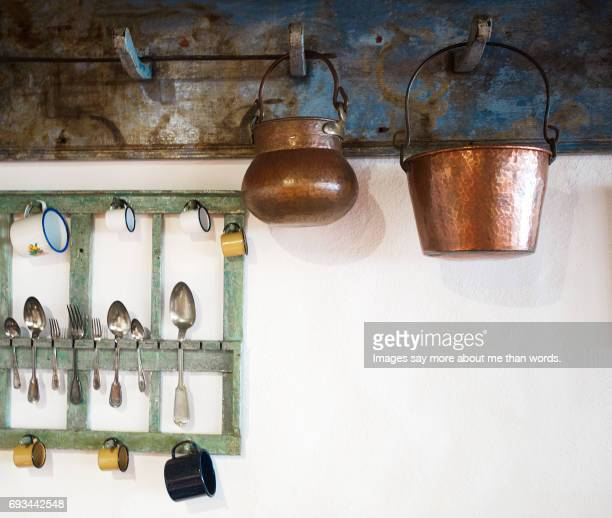 Old kitchen, copper pots, silver spoons.